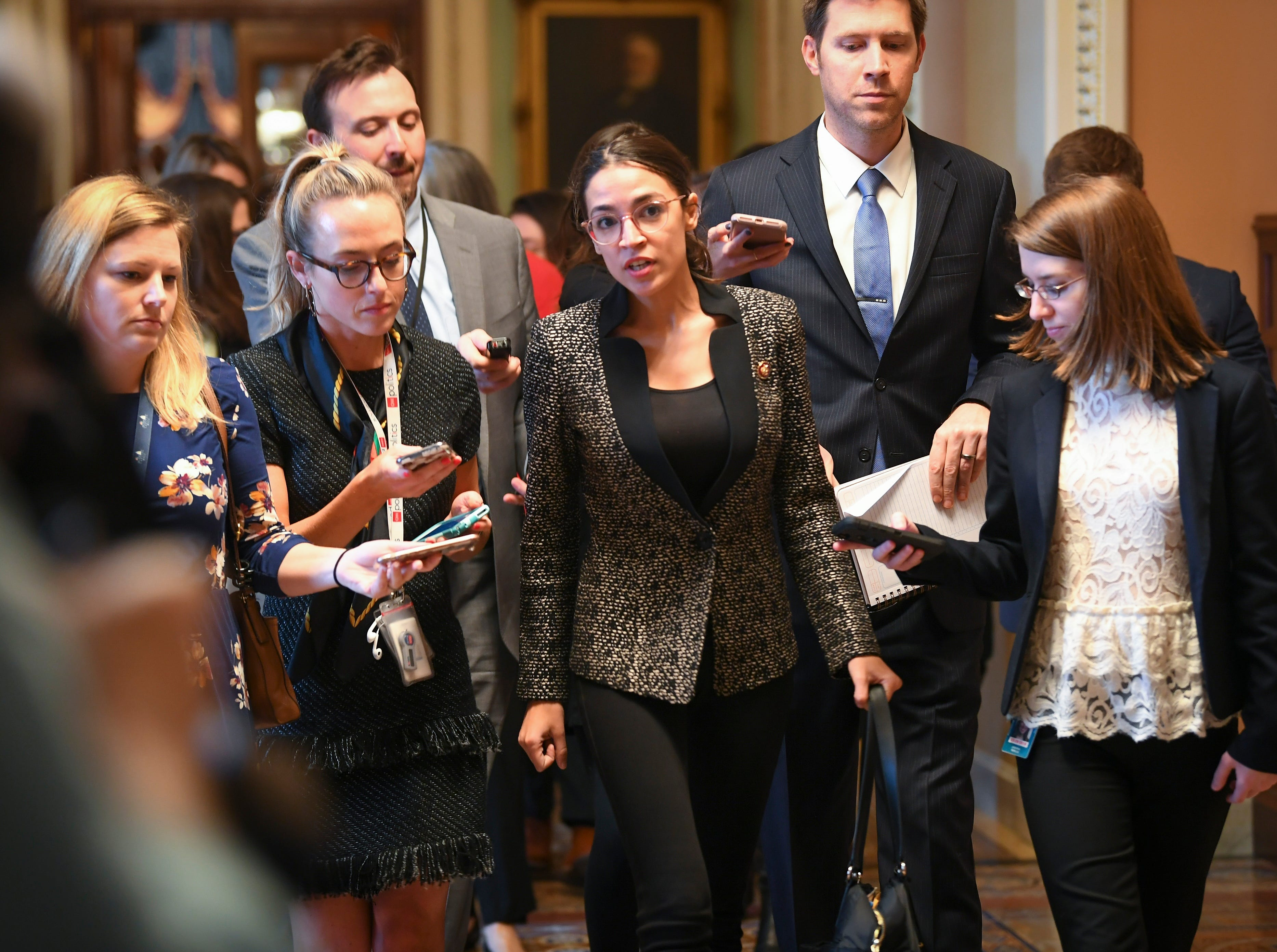 Rep. Alexandria Ocasio-Cortez (D-NY) talks to the media as she and other House Democrat members leave the Senate Chambers after the Senate voted to reject a pair of dueling bills Thursday to fund the federal government and end the longest partial government shutdown in history.