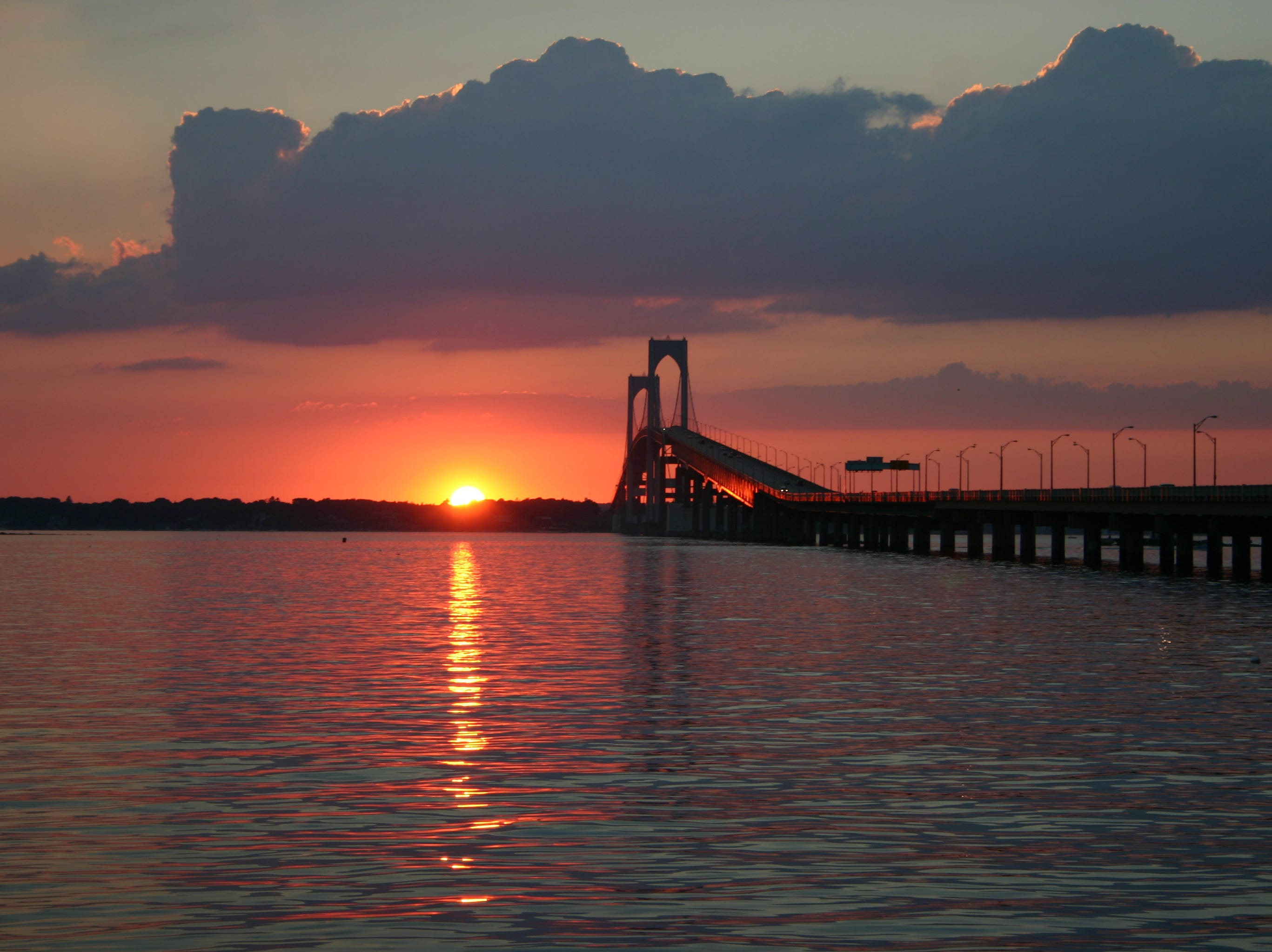 ** FOR IMMEDIATE RELEASE **The sun sets over Conanicut Island as viewed from the Newport side of The Claiborne Pell Bridge in Rhode Island, in this August 2005 photo.  (AP Photo/Larry Price) ORG XMIT: NY423