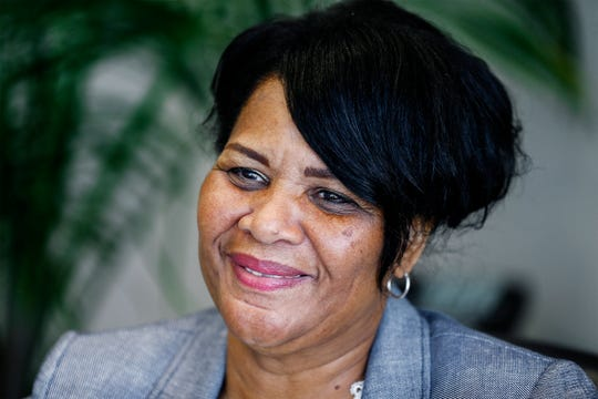 Alice Marie Johnson smiles during an interview at her lawyer's office. President Trump commuted Johnson's life sentence after she served 21 years in prison for a first-time drug offense.