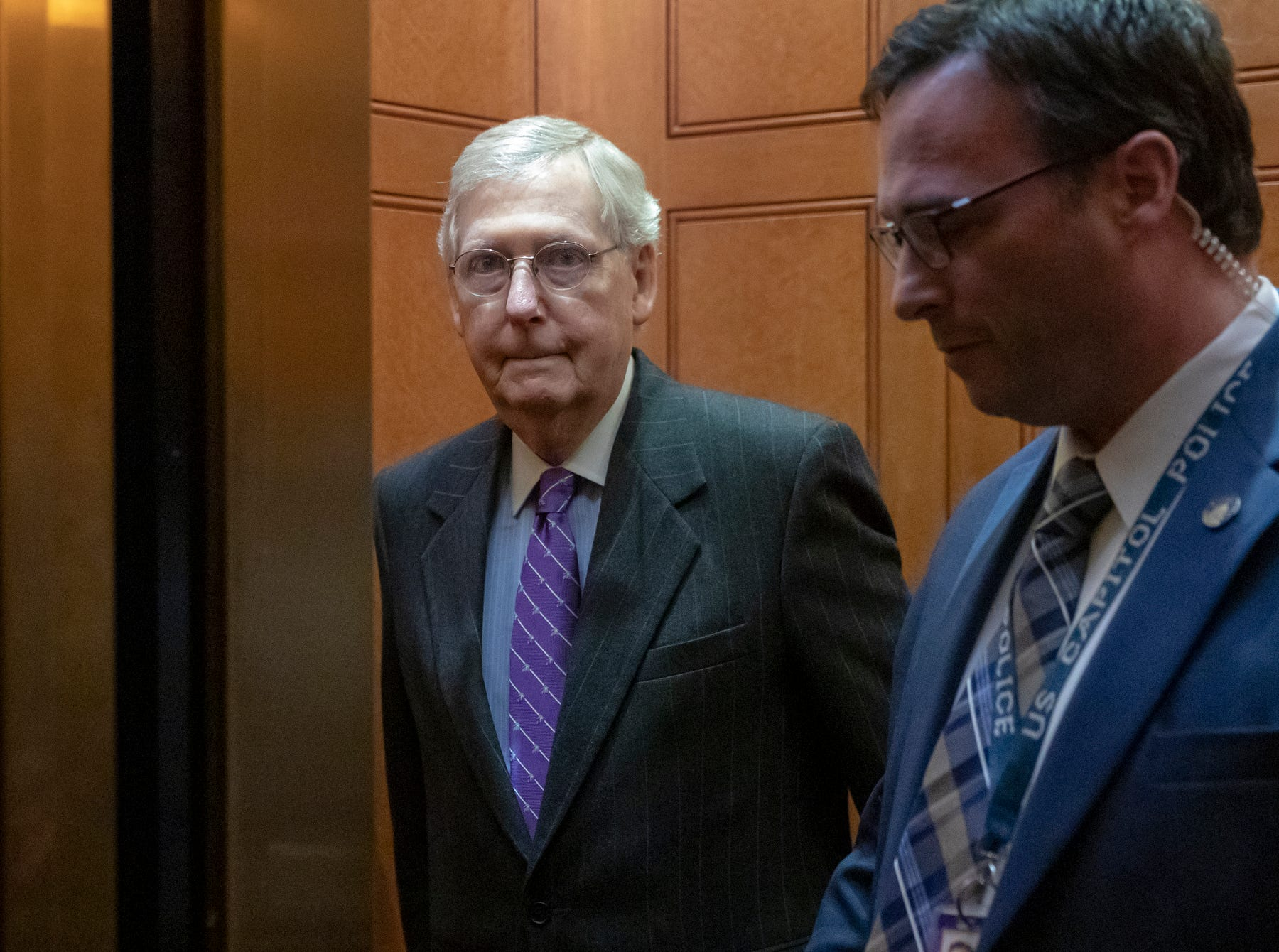 Senate Majority Leader Mitch McConnell, R-Ky., takes an elevator after leaving the chamber, at the Capitol in Washington, Wednesday, Jan. 23, 2019. The Senate will vote on two competing proposals this week to end the partial government shutdown, but neither seems to have enough votes to advance.