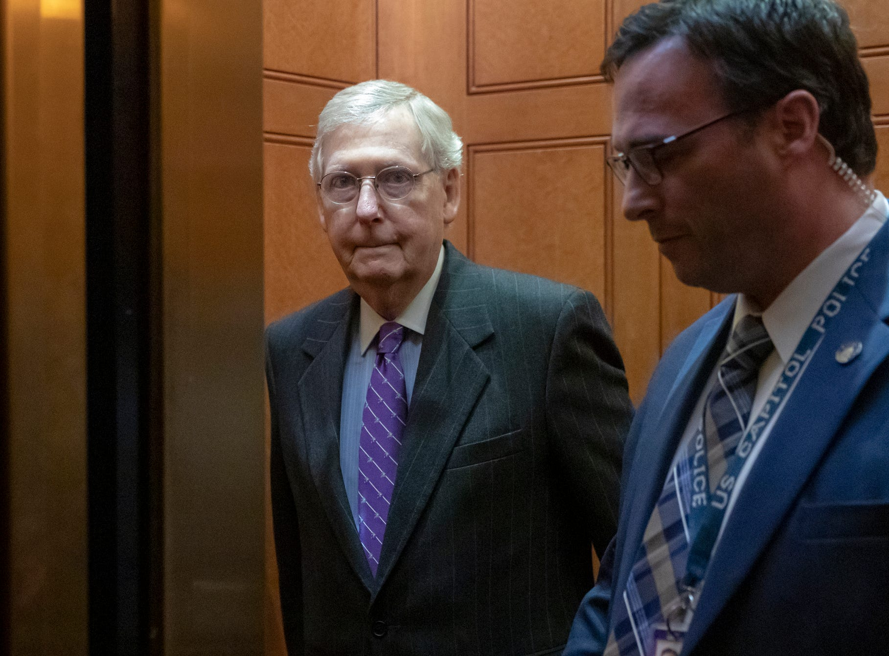 """Senate Majority Leader Mitch McConnell, R-Ky., takes an elevator after leaving the chamber, at the Capitol in Washington Jan. 23, 2019. McConnell said he plans to bring the Democrats' Green New Deal to the floor for a vote so he can put senators """"on record"""" about a plan he calls a """"socialist fantasy to wreck our economy."""""""