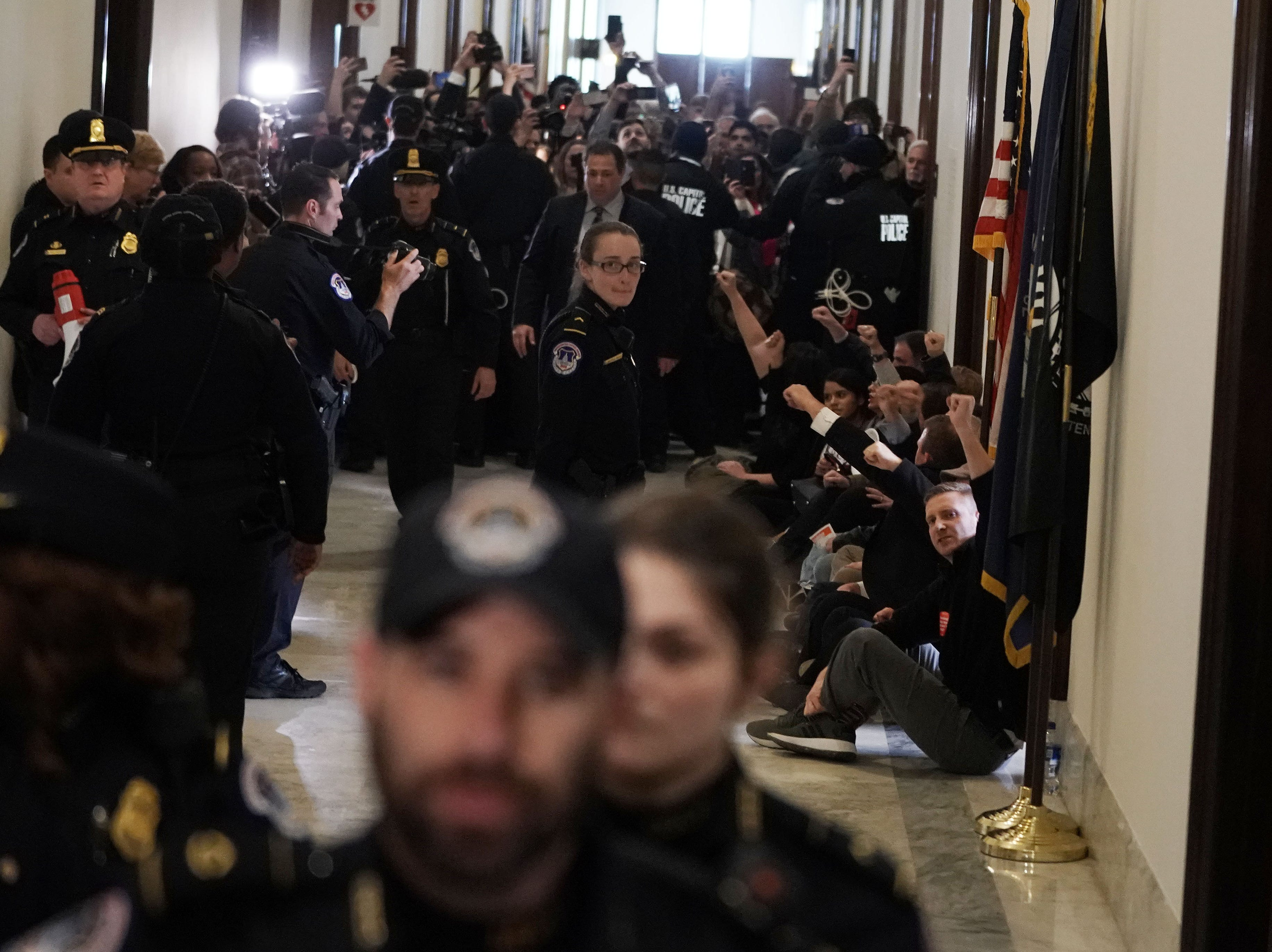 "Union leaders and federal workers participate in a civil disobedience outside the office of Senate Majority Leader Sen. Mitch McConnell (R-KY) at Senate Russell Office Building Jan. 23, 2019 on Capitol Hill in Washington, DC. Federal employees from different unions participated in a ""Occupy Hart"" protest on Capitol Hill against the partial government shutdown."