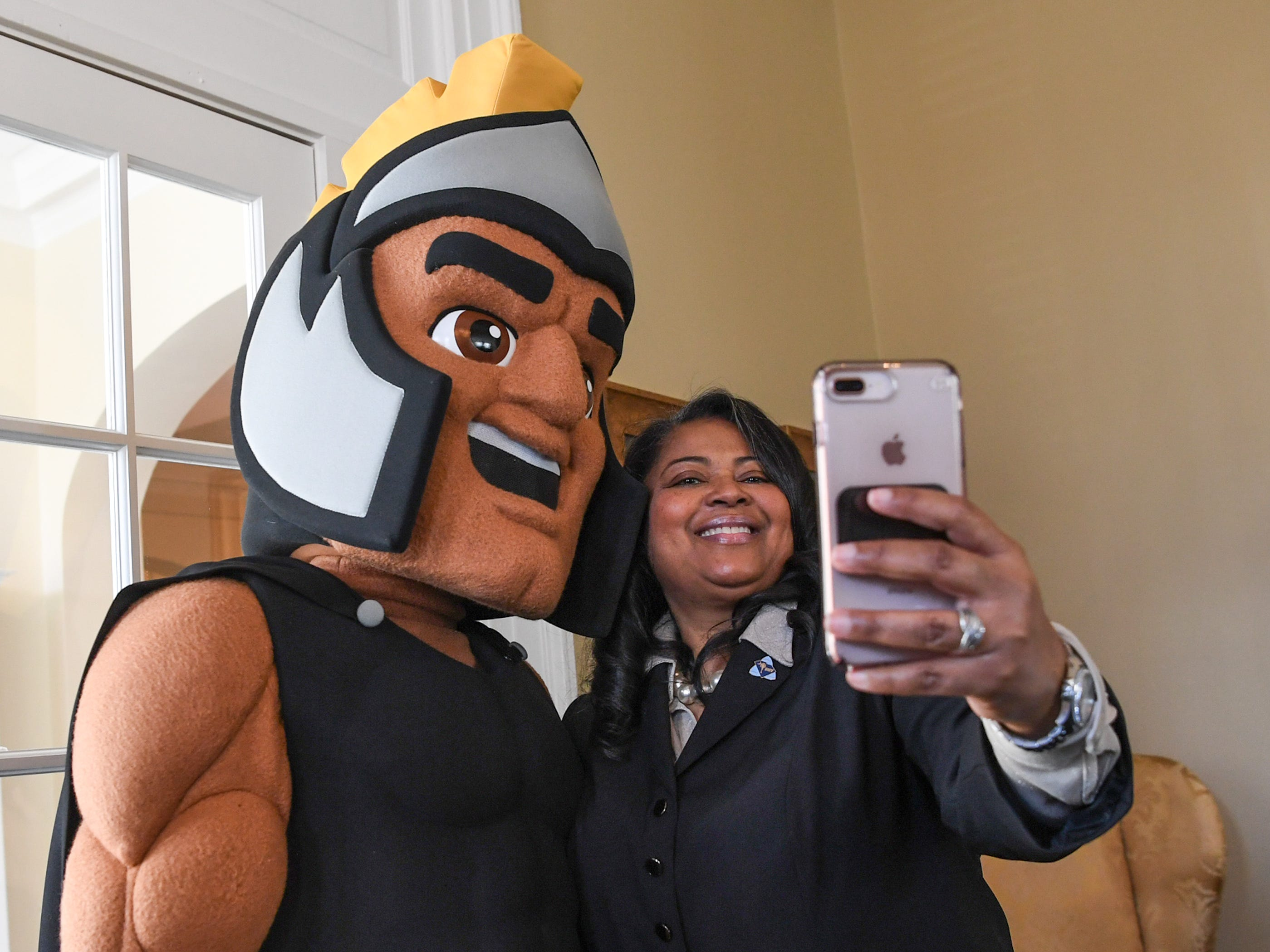 Troy the Trojans mascot of Anderson University poses with Hermena Perkins-Brown, right, plate office director of the South Carolina Department of Motor Vehicles, before showing other officials a new personalized license plate during a press conference at the campus administration building in Anderson Friday morning. The University plate, along with Clemson University and the University of South Carolina, are the only college or university plates available to personalize, said Perkins-Brown. The Anderson University plates can be applied for starting Monday, January 28, 2019 in person, not online, for $100 and an added fee if personalizing.
