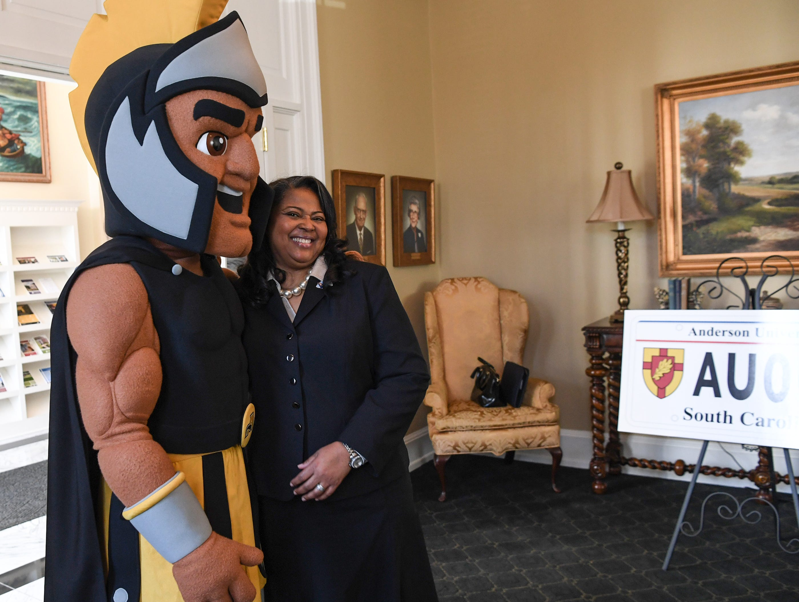 Troy the Trojans mascot of Anderson University stands for a photo with Hermena Perkins-Brown, right, plate office director of the South Carolina Department of Motor Vehicles, before showing other officials a new personalized license plate during a press conference at the campus administration building in Anderson Friday morning. The University plate, along with Clemson University and the University of South Carolina, are the only college or university plates available to personalize, said Perkins-Brown. The Anderson University plates can be applied for starting Monday, January 28, 2019 in person, not online, for $100 and an added fee if personalizing.
