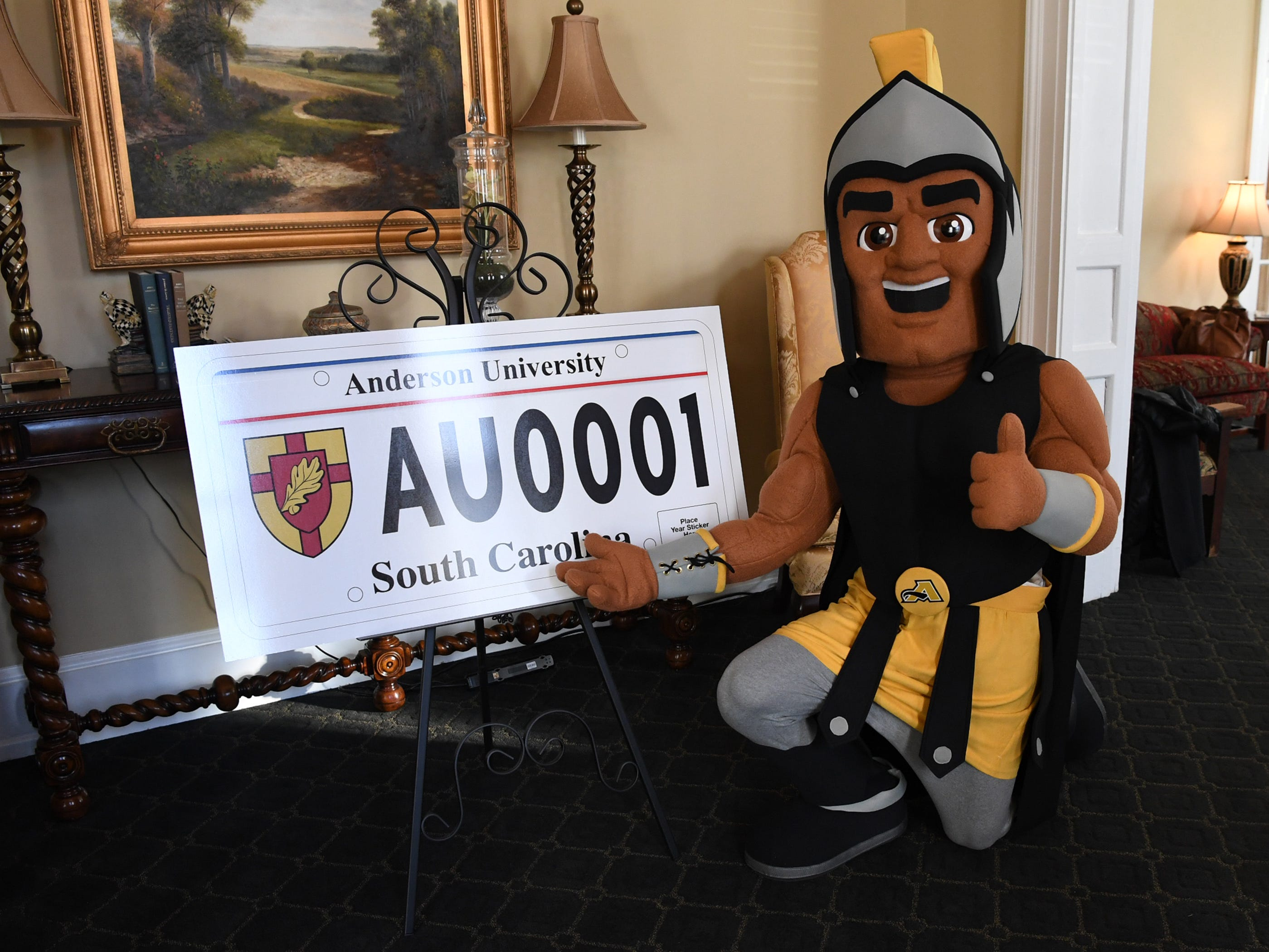 Troy the Trojans mascot of Anderson University stands for a photo before showing other officials a new personalized license plate during a press conference at the campus administration building in Anderson Friday morning. The University plate, along with Clemson University and the University of South Carolina, are the only college or university plates available to personalize, said Perkins-Brown. The Anderson University plates can be applied for starting Monday, January 28, 2019 in person, not online, for $100 and an added fee if personalizing.