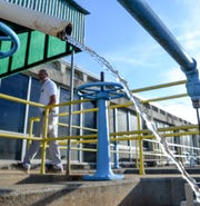 Mitch Ellenburg, general manager at the Belton Honea Path Water Authority in Honea Path walks by Saluda River water in the first of six filtration steps at the plant on Friday.