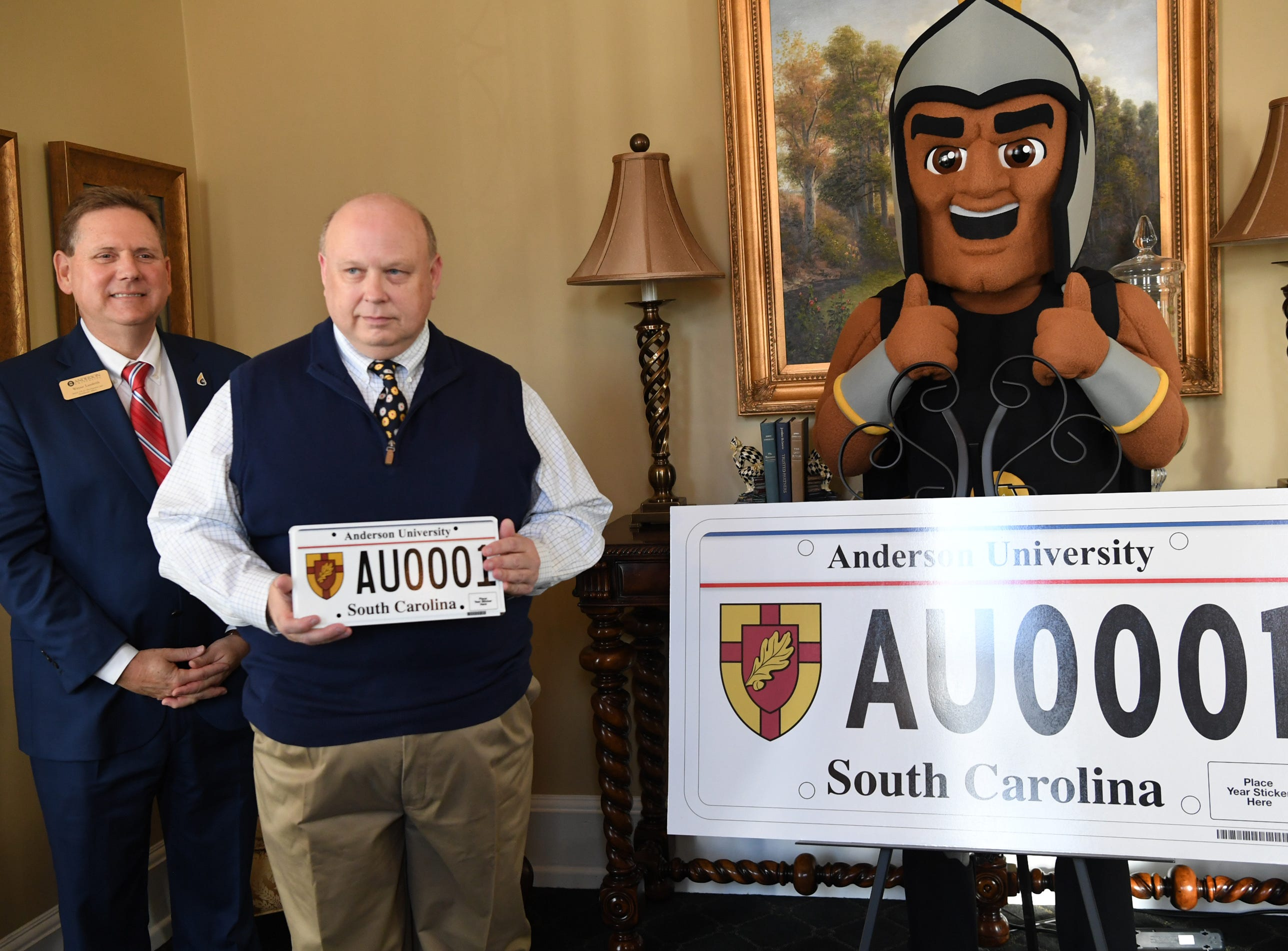Wayne Landrith, left, President Evans Whitaker, middle, and Troy the Trojans mascot of Anderson University show other officials a new personalized license plate during a press conference at the campus administration building in Anderson Friday morning. The University plate, along with Clemson University and the University of South Carolina, are the only college or university plates available to personalize, said Perkins-Brown. The Anderson University plates can be applied for starting Monday, January 28, 2019 in person, not online, for $100 and an added fee if personalizing.