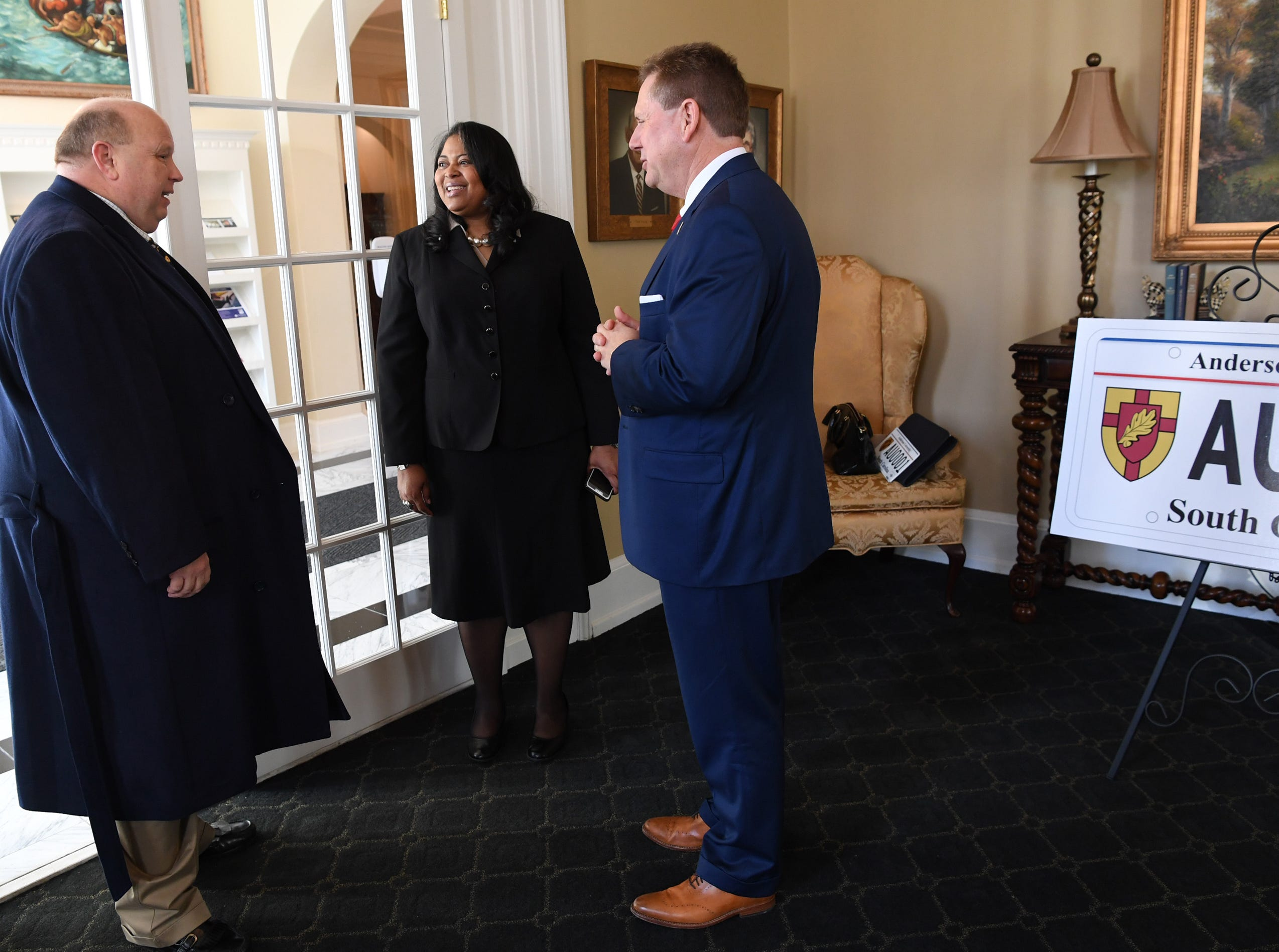President Evans Whitaker, left, of Anderson University, Hermena Perkins-Brown, right, plate office director of the South Carolina Department of Motor Vehicles, and Wayne Landrith, right, meet before announcing a new personalized license plate during a press conference at the campus administration building in Anderson Friday morning. The University plate, along with Clemson University and the University of South Carolina, are the only college or university plates available to personalize, said Perkins-Brown. The Anderson University plates can be applied for starting Monday, January 28, 2019 in person, not online, for $100 and an added fee if personalizing.