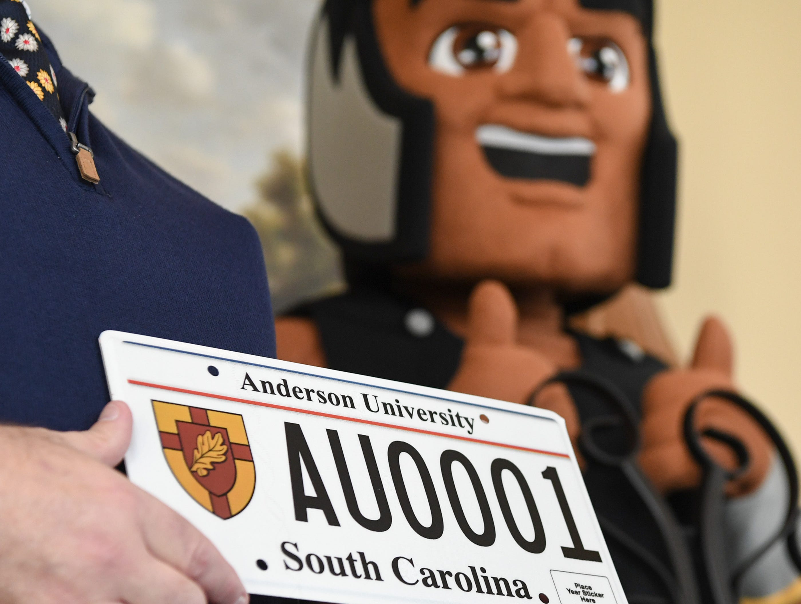 President Evans Whitaker of Anderson University shows other officials a new personalized license plate during a press conference at the campus administration building in Anderson Friday morning. The University plate, along with Clemson University and the University of South Carolina, are the only college or university plates available to personalize, said Perkins-Brown. The Anderson University plates can be applied for starting Monday, January 28, 2019 in person, not online, for $100 and an added fee if personalizing.