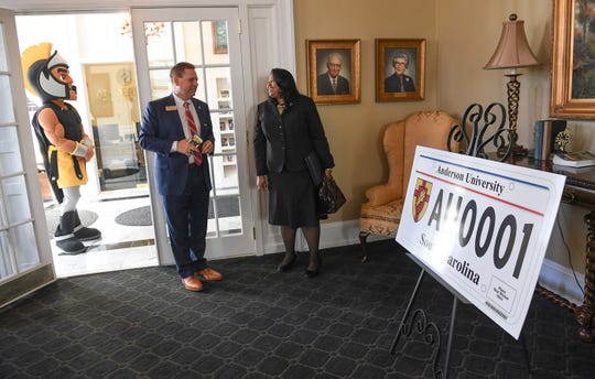 Wayne Landrith, left, talks with Hermena Perkins-Brown, left, plate office director of the South Carolina Department of Motor Vehicles, during an announcement of a new personalized license plate during a press conference at the campus administration building in Anderson Friday morning. The University plate, along with Clemson University and the University of South Carolina, are the only college or university plates available to personalize, said Perkins-Brown. The Anderson University plates can be applied for starting Monday, January 28, 2019 in person, not online, for $100 and an added fee if personalizing.