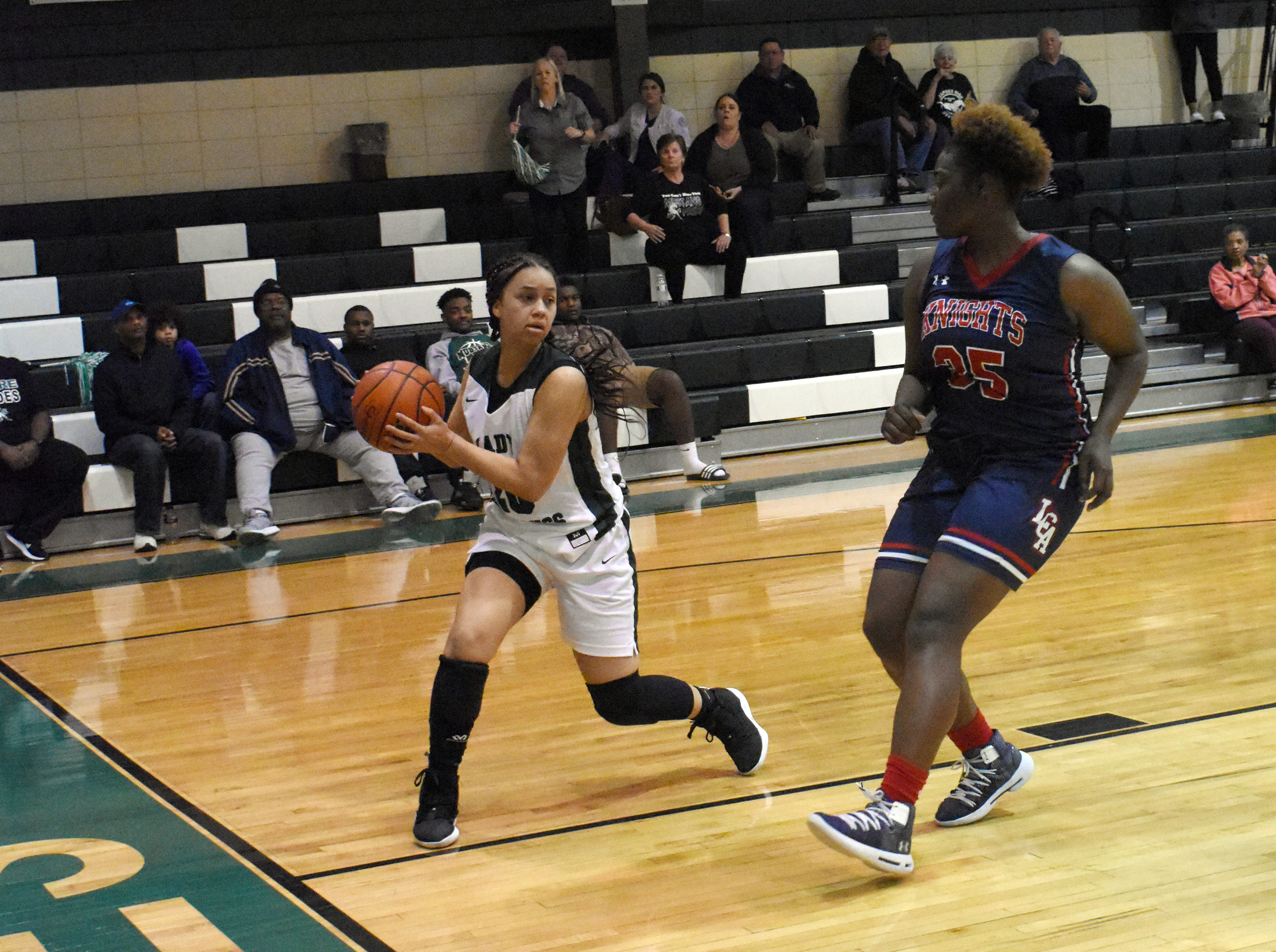Lafayette Christian post player and Alcorn State commit Bre Porter (35) closes in on Rapides' Naomi Lewis Thursday.