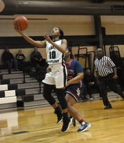 Rapides point guard Darlynetta Martin (10) goes for a layup against Lafayette Christian Thursday, Jan. 24, 2019.