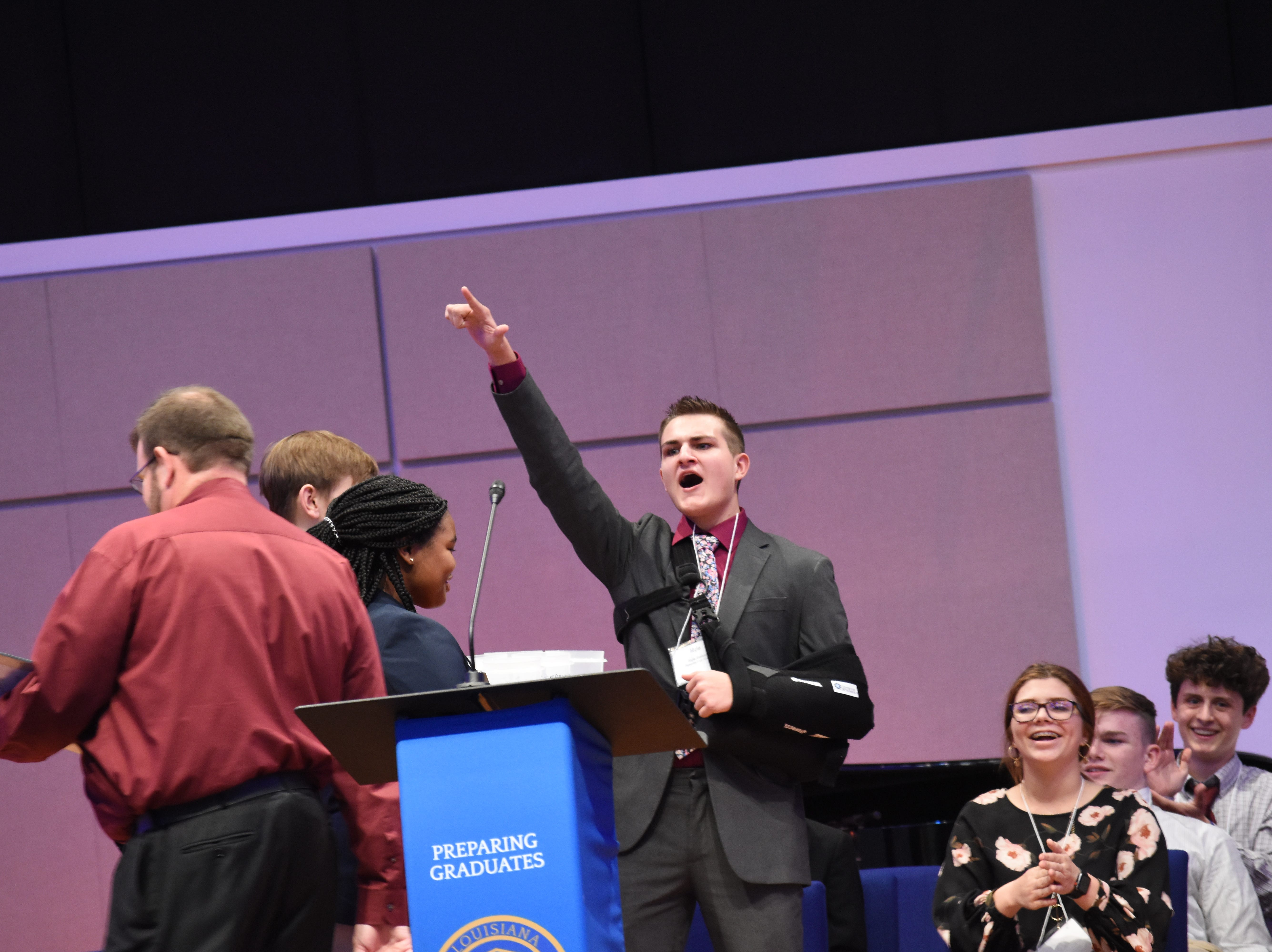 Kyle Bosley, a 10th grade student from Rosepine High School, celebrates after correctly answering an entertainment question in a current events event that was part of the Future Business Leaders of America event held at Louisiana College Thursday, Jan. 254, 2019. The Pitkin High School Chapter of the Future Business Leaders of America hosted its annual conference at the college. About 500 students from various high schools throughout the region attended. Students took various tests in subjects such as advertising, economics and business math and attended classes in subjects such as broadcast journalism, impromptu speaking and public speaking.