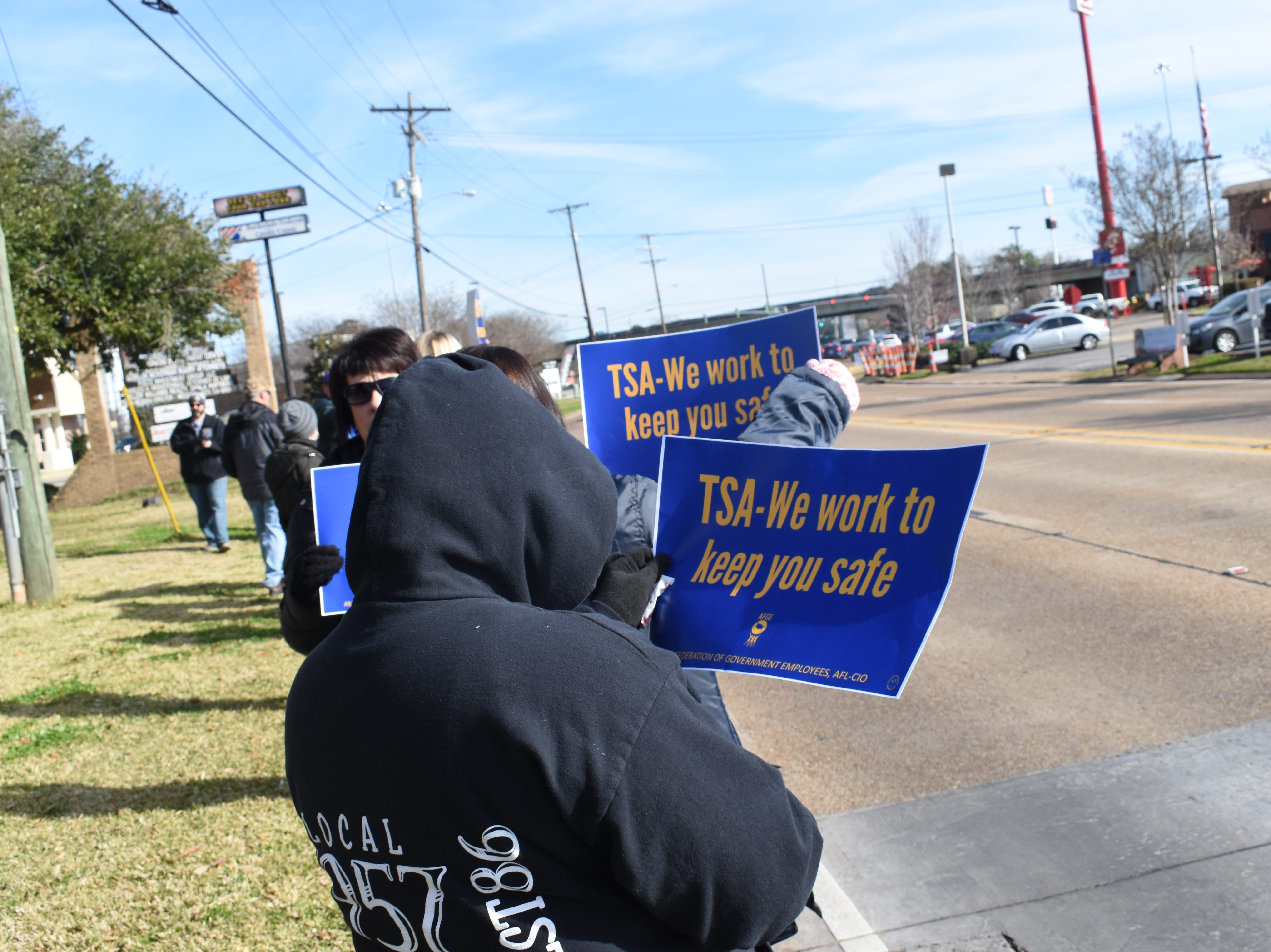 American Federation of Government Employees Local 1034 rally outside U.S. Sen.Bill Cassidy's office located on Jackson Street Extension on Friday, Jan. 25, 2019. Most were from the Federal Correctional Complexes in Pollock and Oakdale.The rally continued at outside the office of U.S. Sen. John Kennedy located on Coliseum Blvd. Approximately 50 people participated in the rally. 