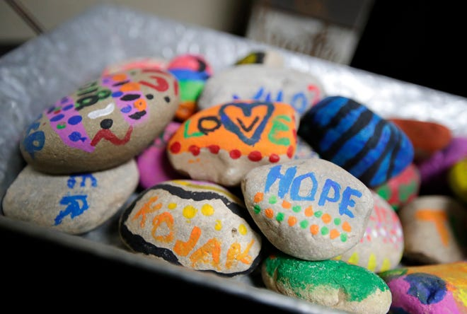 A collection of rocks painted by the patients of Shari Schroeder, a substance abuse counselor at Addiction Medical Solutions, an opioid treatment program in Oshkosh. Schroeder plans to make a rock garden out of the stones.