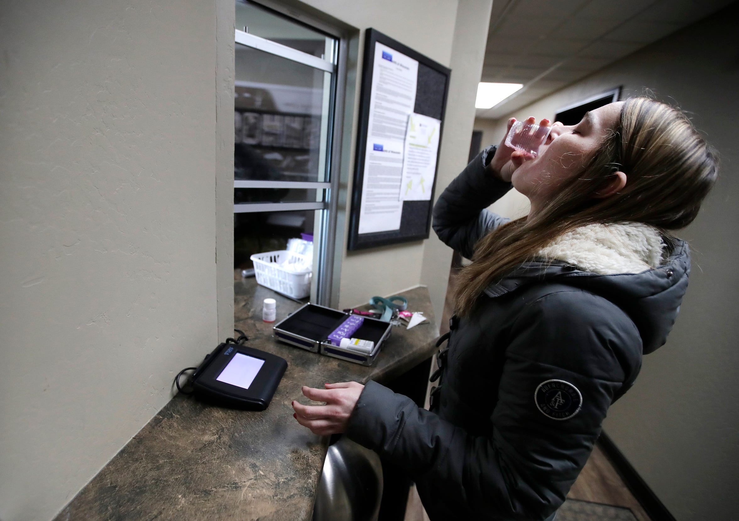 Bridget Petrie takes a dose of methadone after her counseling session at Addiction Medical Solutions, an opioid treatment program in Oshkosh.