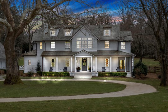 Tour sleek farmhouse-style mansion  at 117 Ridge Road in Rumson.