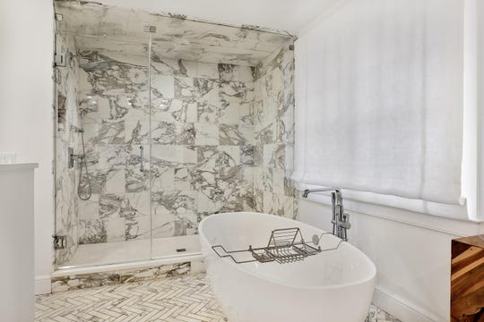 Master bath offers double sinks, a jetted tub, with Marble steam shower.
