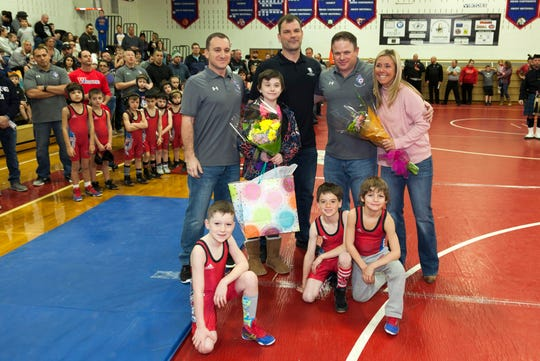 Posing at the Wall Takedown Pediatric Cancer Tournament:  (back row, left to right) Michael Parnell, Grace Philhower, Rob Philhower, Ray Boulard and Jackie Philhower. Front row left to right:  wrestlers Nolan Parnell, Finn Rafferty, Jackson Pressman.