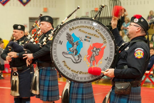 Members of Monmouth County Police & Fire Pipes & Drums perform at the Wall Takedown Pediatric Cancer Tournament.