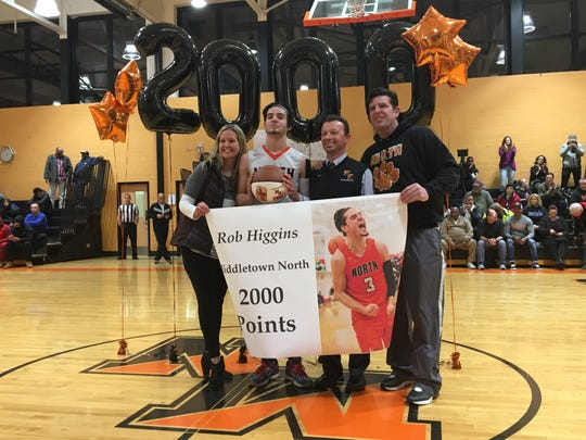 With his parents on the end, his coach (Mike Iasparro) in the center, Middletown North's Rob Higgins (2nd from the left) celebrates his career milestone (2,000 career points) on Jan. 24, 2019 at Middletown North High School in a 66-63 loss to Neptune.