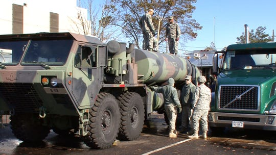 Members of the New Jersey National Guard fuel emergency vehicles at the Freehold armory in this 2012 file photo.