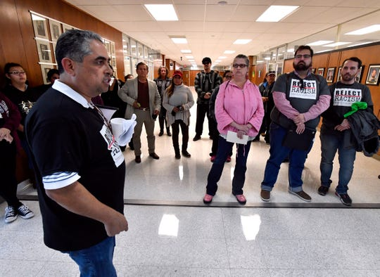 Abilene ISD board member Samuel Garcia leads protesters in chants against the Abilene City Council outside of the chambers at City Hall on  Jan. 24, 2019.