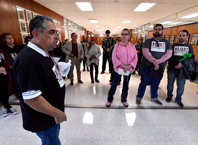 AISD board member Samuel Garcia leads protesters in chants against the Abilene City Council outside of the chambers at City Hall on Thursday. The group was angry that the council did not allowing an agenda change to allow for public comment before the vote to censure Councilman Kyle McAlister.