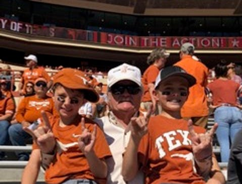 John Compere, of Baird, enjoys a Texas Longhorn football game with his grandsons Dylan, of Austin, and Ryder, of Callahan County.