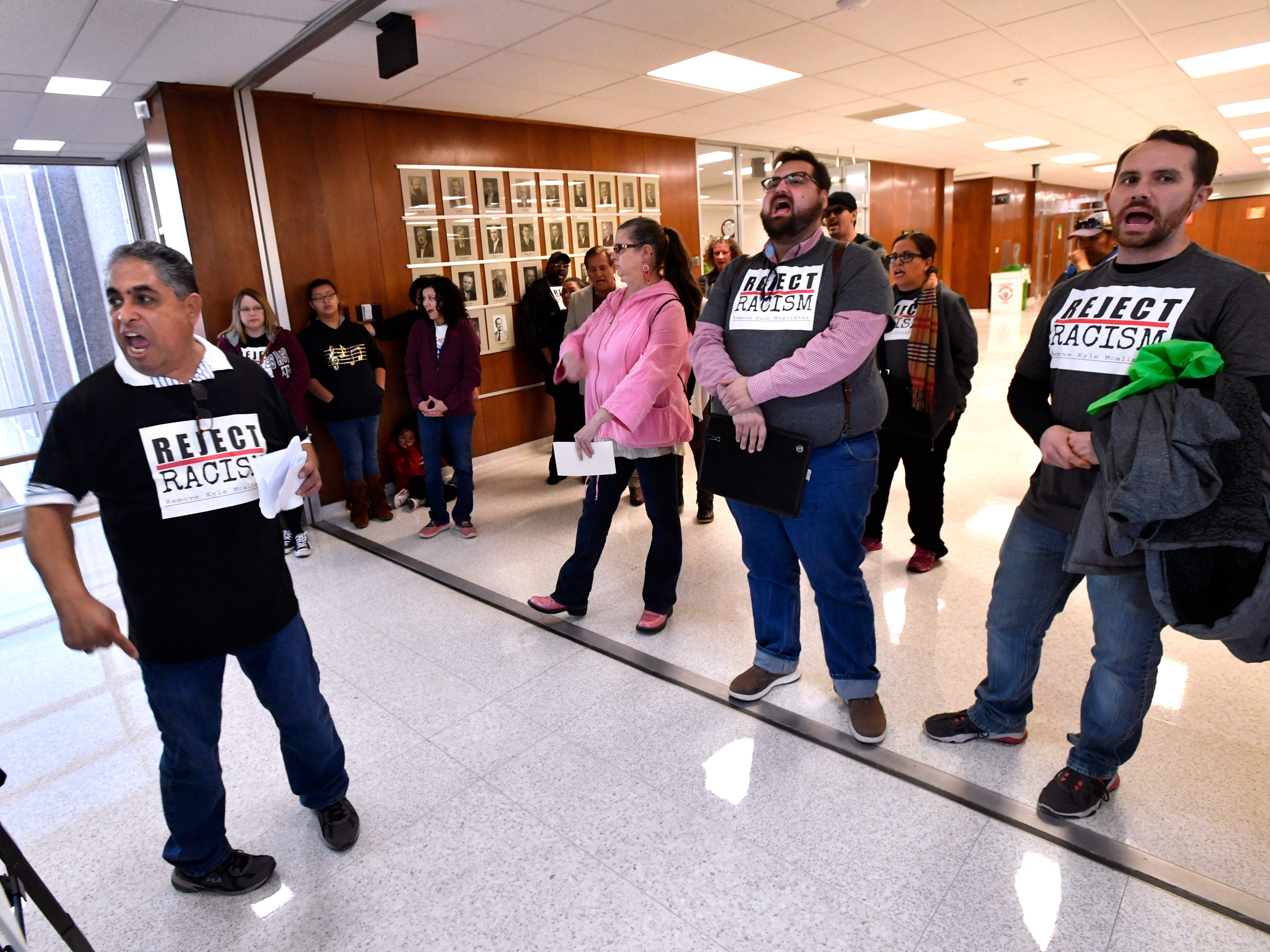 "AISD board member Samuel Garcia (left) and others chant ""Shame, shame!"" after the Abilene City Council voted not to change the agenda to allow for public comment before voting on the censure of member Kyle McAlister Thursday Jan. 24, 2019. Garcia and others left the chambers to stand in the hallway outside to voice their displeasure. The motion to censure McAlister for social media posts Garcia and others have labeled racist did not pass."