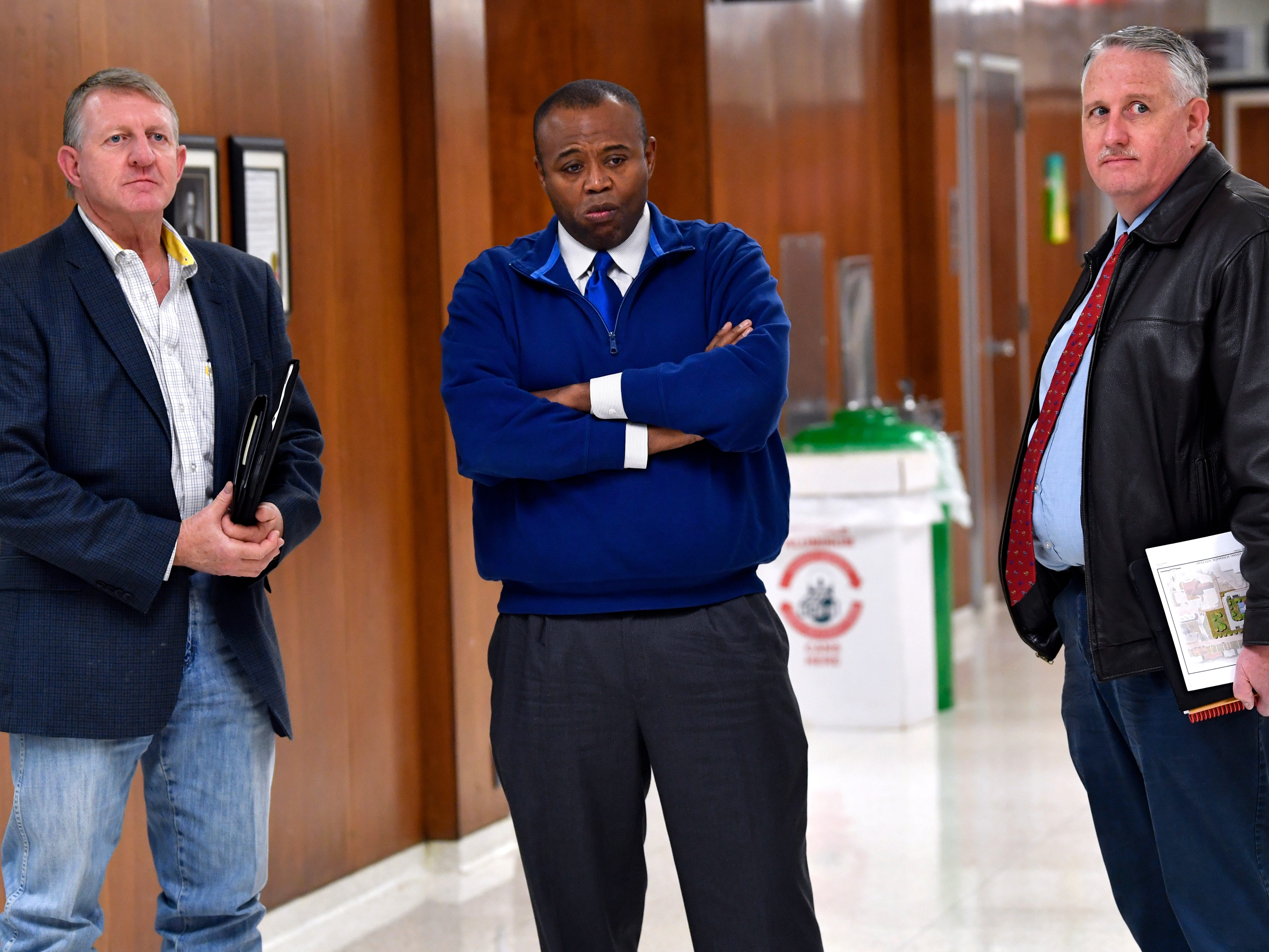 Abilene City Councilman Weldon Hurt (left), Mayor Anthony Williams, and Councilman Shane Price listen to hard questions asked of fellow Councilman Kyle McAlister by reporters after Thursday's council meeting Jan. 24, 2019. The measure to censure McAlister for remarks community members have labeled as racist did not pass Thursday.