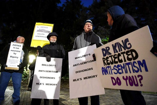 People protest outside Lipinsky Hall before Tamika Mallory's speech at UNC Asheville Jan. 24, 2019. Mallory has been the subject of criticism in the past year for refusing to condemn Nation of Islam leader Louis Farrakhan, who regularly makesanti-Semitic, homophobic and otherwise offensive remarks.