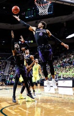 Washington's Matisse Thybulle pulls down a rebound during the team's NCAA college basketball game against Oregon on Thursday, Jan. 24, 2019, in Eugene, Ore. (AP Photo/Thomas Boyd)