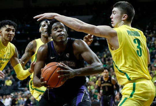 Washington forward Noah Dickerson, looks for a shot as Oregon guard Payton Pritchard (3) defends during an NCAA college basketball game Thursday, Jan. 24, 2019, in Eugene, Ore. (AP Photo/Thomas Boyd)