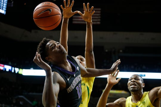 Washington forward Nahziah Carter (11) loses control of the ball during the team's NCAA college basketball game against Oregon on Thursday, Jan. 24, 2019, in Eugene, Ore. (AP Photo/Thomas Boyd)