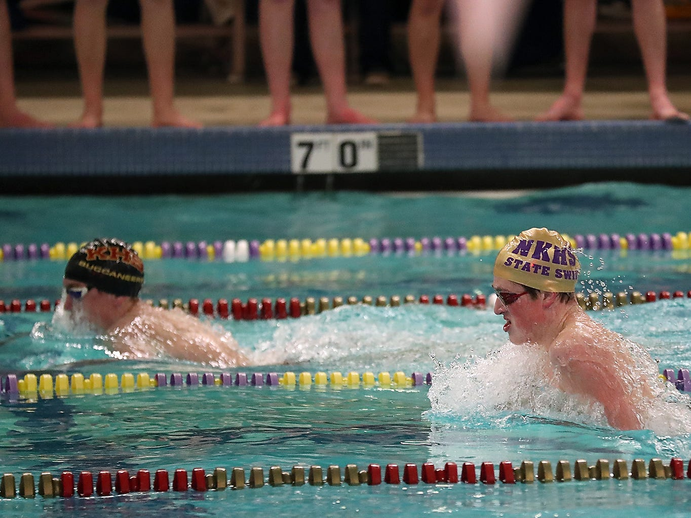 North Kitsap's Nathan Ramey (right) competes in the 200 Yard IM during their meet against Kingston on Thursday, January 24, 2019.