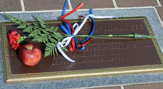 On Jan. 27, 2018, a flower and an apple were placed on a plaque honoring Challenger crew member Christa McAuliffe during the Astronaut Memorial Ceremony at Sand Point Park in Titusville.