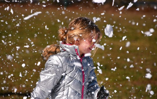 Allison McKinsey stands in a blizzard. It was their annual Snow Day at Faith Fellowship Academy in Melbourne Friday morning and Gentleman's Ice out of Jacksonville brought their snow machine and tons of ice to make a winter wonderland for the students.