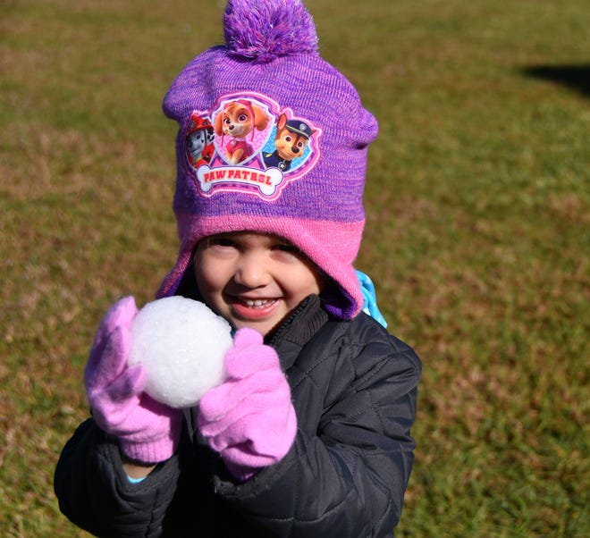 Leighton Fowler shows off a perfect snowball. It was their annual Snow Day at Faith Fellowship Academy in Melbourne Friday morning and Gentleman's Ice out of Jacksonville brought their snow machine and tons of ice to make a winter wonderland for the students.