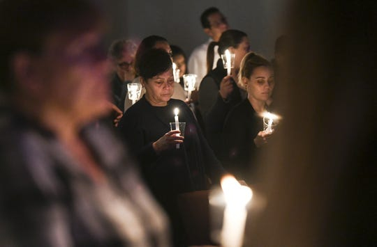 Churchgoers hold candles at Nuevo Pacto United Methodist Church in Sebring in memory of Marisol Lopez and the other victims of a shooting at SunTrust Bank.