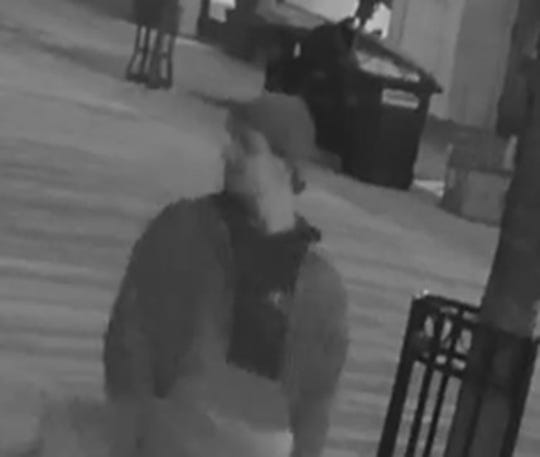 Burlington Police Department issued this photo of a second man believed to be a witness to an early morning assault on Jan. 18, 2019. Other photos show the man was wearing a blue jacket with a black hoodie underneath and a gray hat.