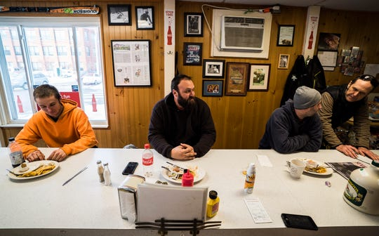 From left, Derek Merusi of Randolph, Ryan Hopper of Westford, and Jon Lawrence of Eden grab breakfast at Handy's Lunch on Maple Street in Burlington on Friday morning, Jan. 25, 2019. The Free Press tested out Maple Stream, a new maple syrup in a can from Coombs Family Farms, with the breakfast crowd there.