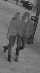 Burlington Police Department issued this photo from a downtown surveillance camera showing a male assault suspect and a woman they believe witnessed an assault on January 18, 2019. Other photos of the man showed his jacket was either dark blue or black with a blue inner lining.