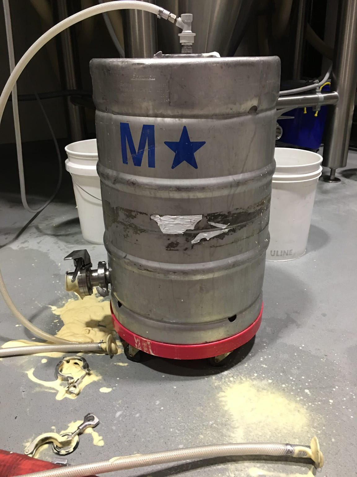 A keg used to hold yeast at The Alchemist in Stowe — remnants of the foamy yeast mixture has spilled onto the floor.
