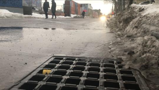 Rain and melting slush drain down Bank Street in Burlington on Thursday in the wake of Winter Storm Harper. Photographed  Jan. 24, 2019.
