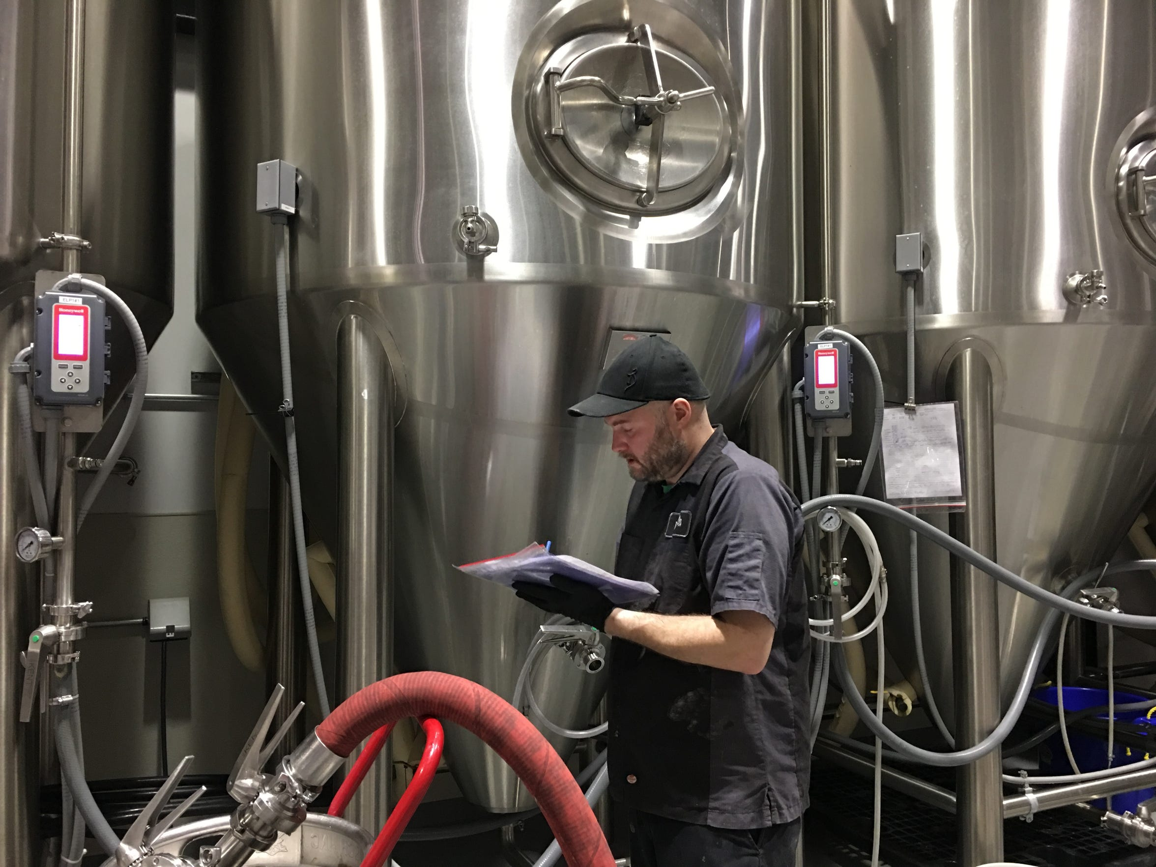 Jim Conroy takes notes on the day's brew of Ouroboros before calling it at night at The Alchemist in Stowe on Jan. 17, 2019.