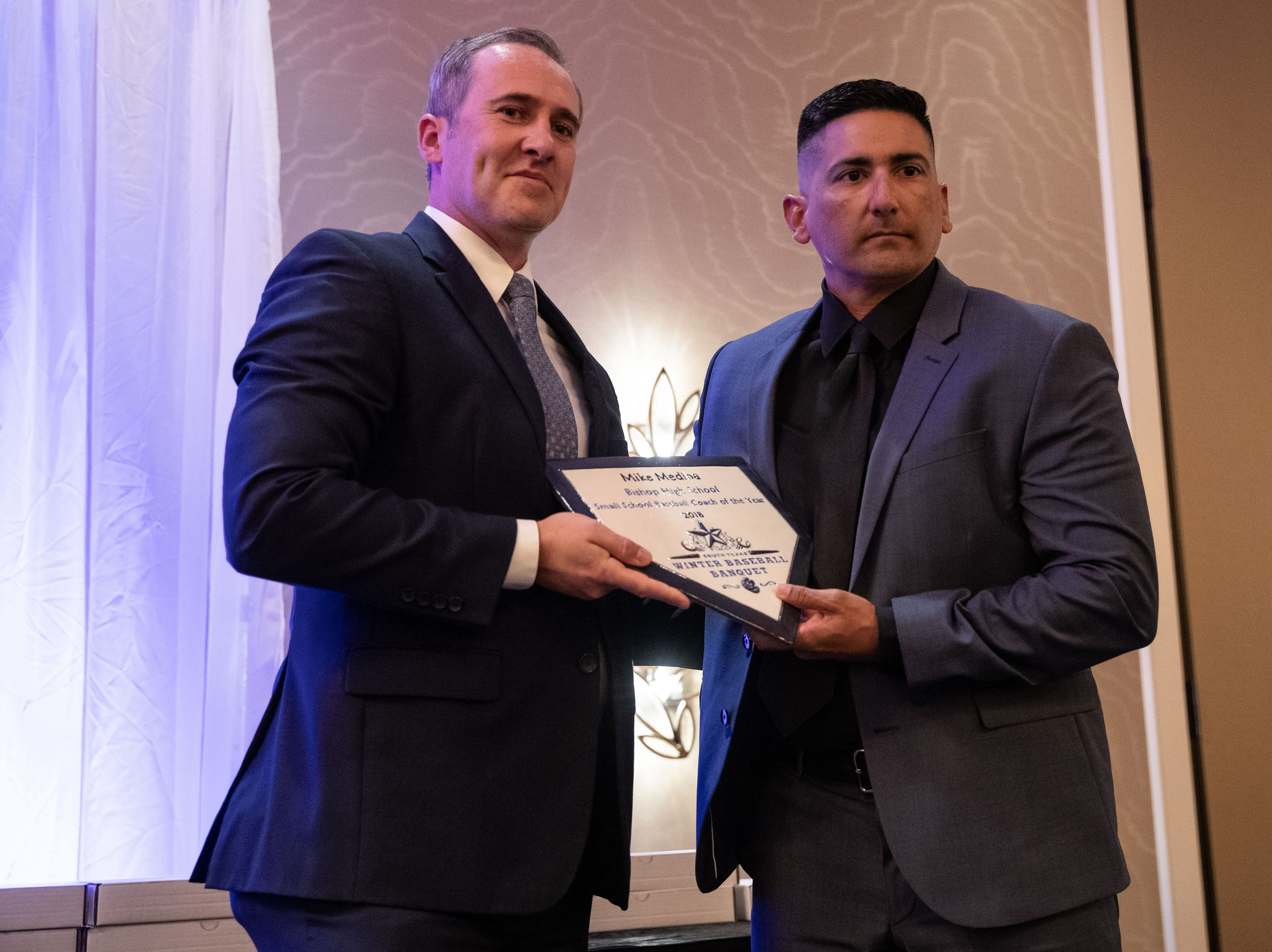Bishop's Mike Medina receives the small school baseball coach of the year award during the Hooks South Texas Baseball Banquet at the Omni Hotel on Thursday, Jan. 24, 2019.
