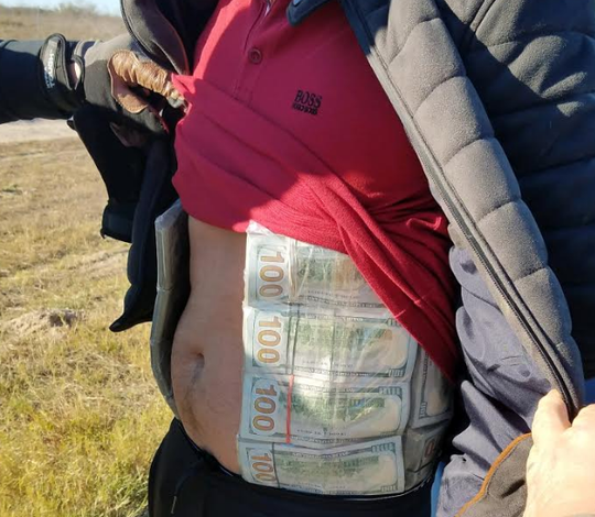 South Texas Specialized Crimes and Narcotics Task Force agents seized cash tied to a man's torso during a traffic stop in Brooks County on Wednesday, Jan. 23, 2019.