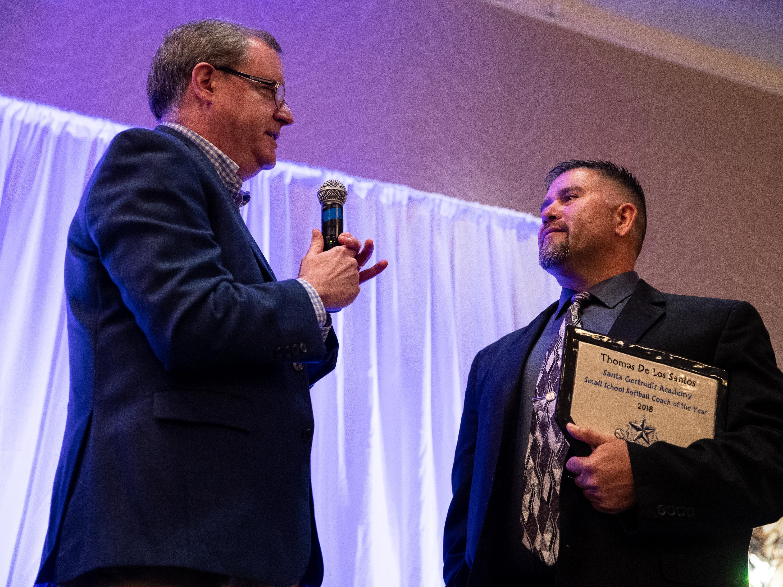 Santa Gertrudis Academy's Tomas De Los Santos receives the small school softball coach of the year award during the Hooks South Texas Baseball Banquet at the Omni Hotel on Thursday, Jan. 24, 2019.
