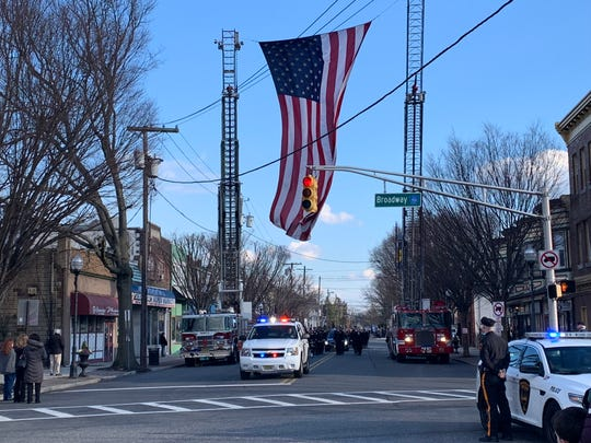 Former Gloucester City Mayor William James' funeral process sets off on Monmouth Street from the McCann-Healey Funeral Home to St. Mary's Church Jan. 25. 2019.